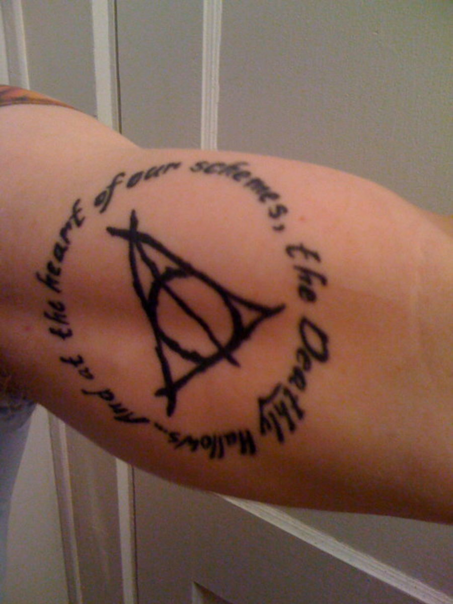 "Deathly Hallows tattoo with quote: ""And at the heart of our schemes, the Deathly Hallows"""