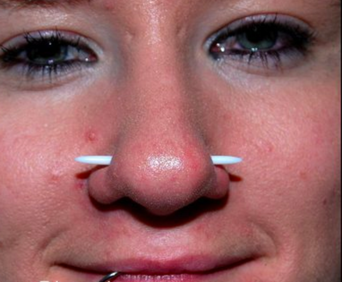 An Austin bar piercing goes through the nose tissue but not the septum.