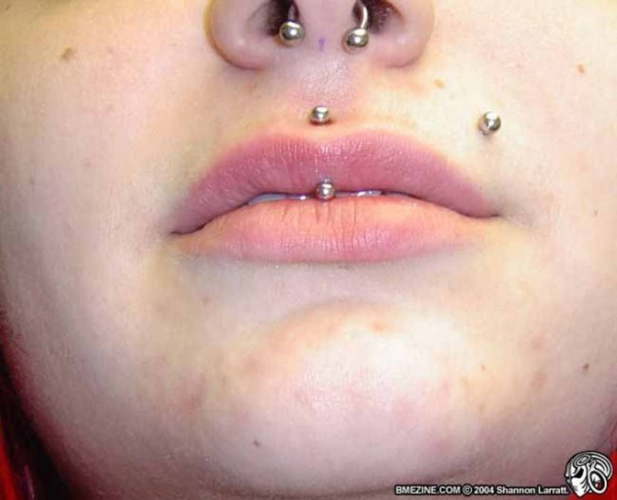 The jestrum piercing is the vertical piercing through the upper lip.