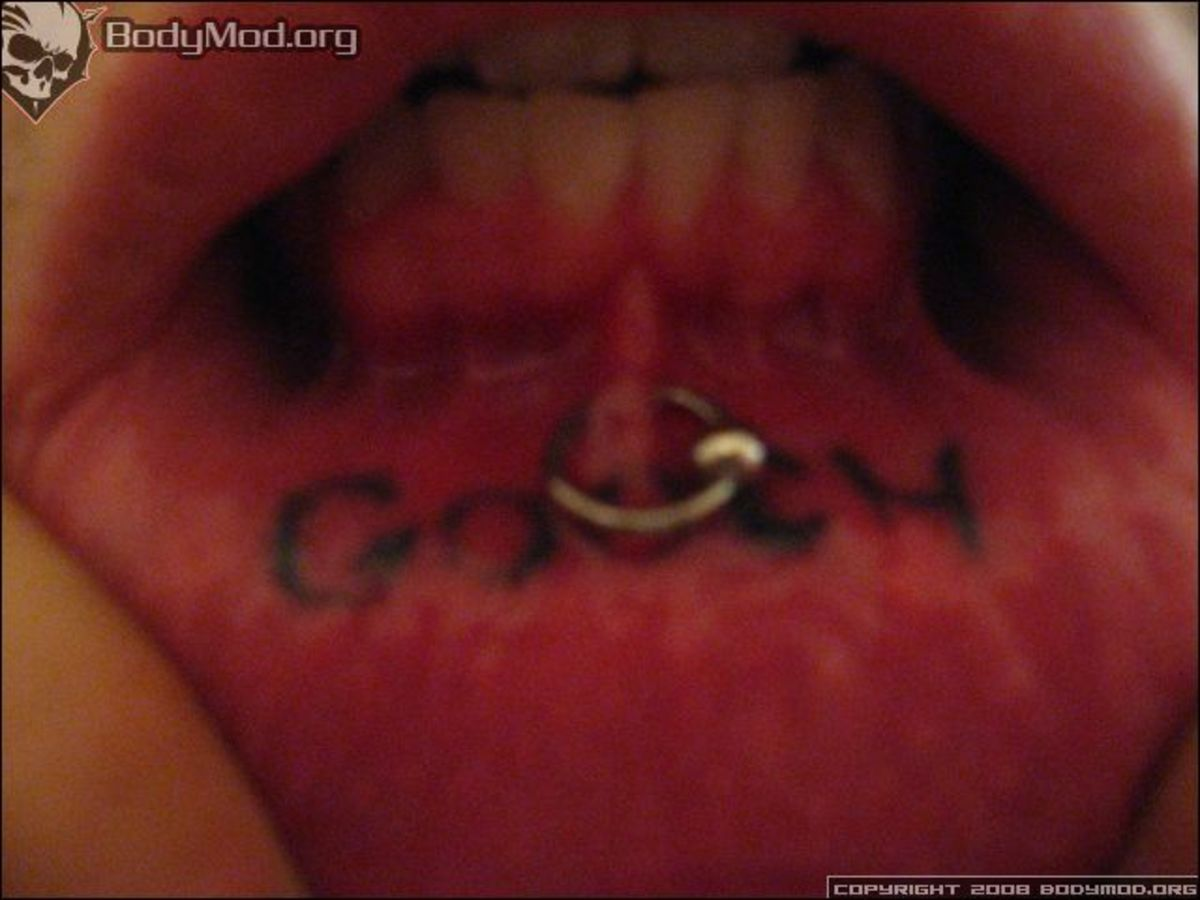 A frowny is a piercing of the lower frenulum.