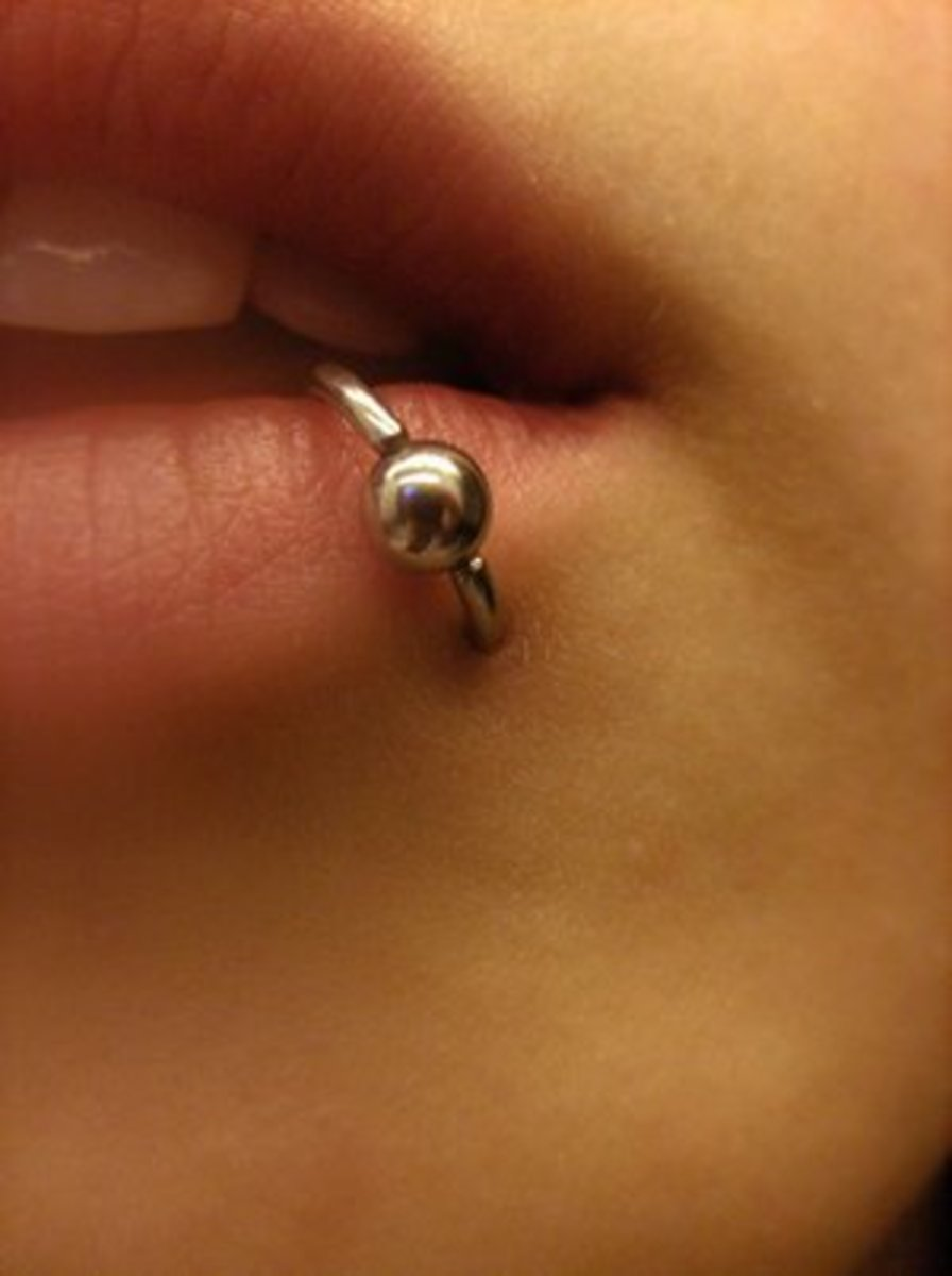 A lower lip piercing does not actually pierce the lip itself, but rather the skin below and inside the lip.
