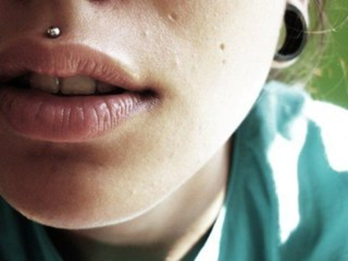 A medusa piercing is similar to a labret piercing but  is positioned between the nose and the upper lip.