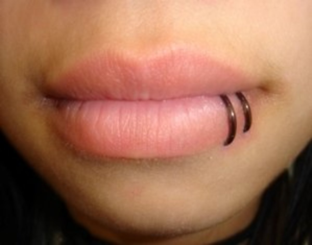 A double piercing with rings near the corner of the lower lip is called a spider bite piercing.