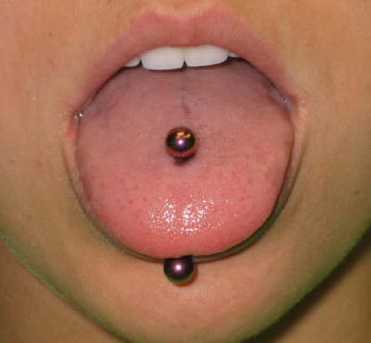 A traditional tongue piercing goes straight through the tongue.