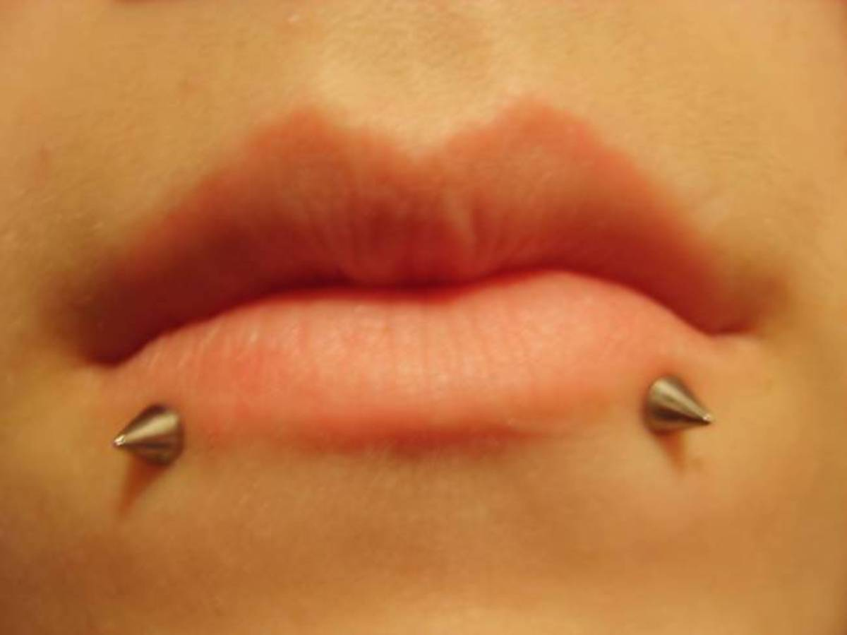 "Snake bites are a double piercing below the lower lip. See ""bites"" description above."