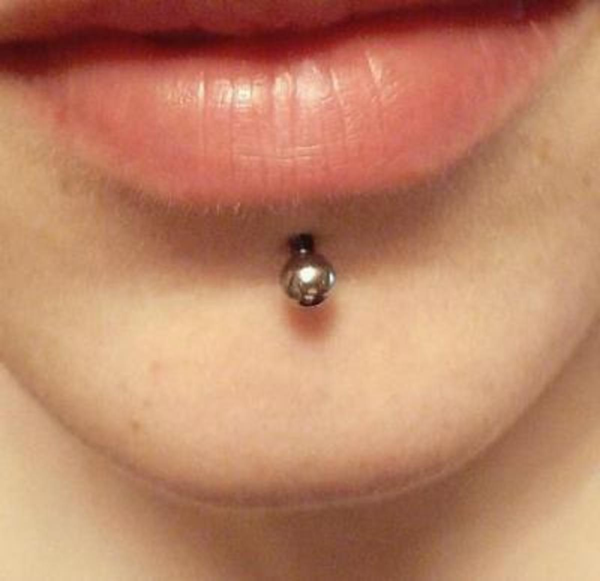 A chin piercing, or labret.