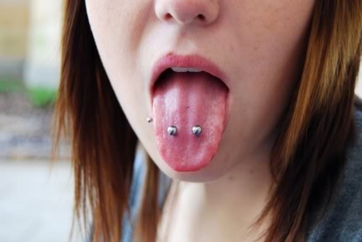 Venom bites piercings sit on either side of the two main blood vessels in the tongue.