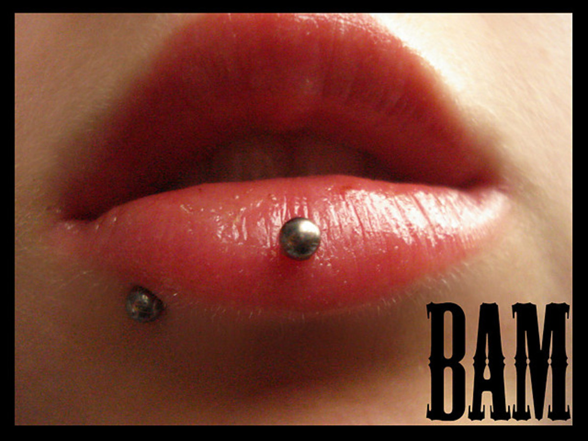 The Ashley piercing is the stud in the center of her lower lip.