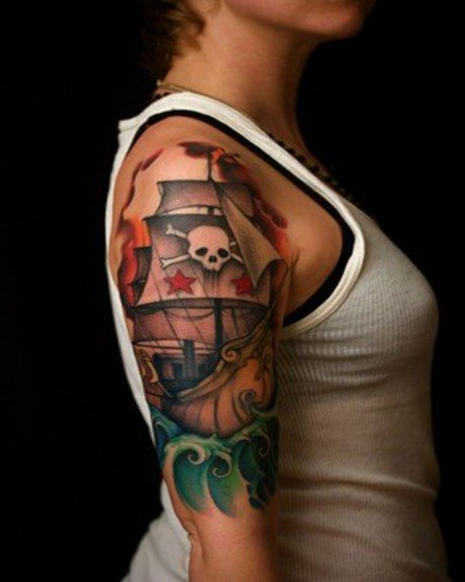 big, colorful pirate ship tattoo