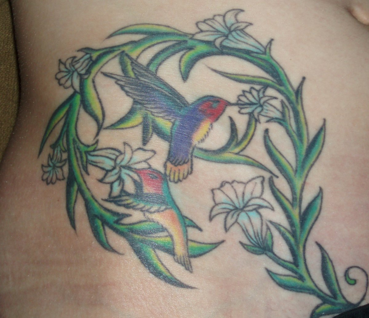 Hummingbird tattoos meanings designs history and photos tatring source urmus Gallery
