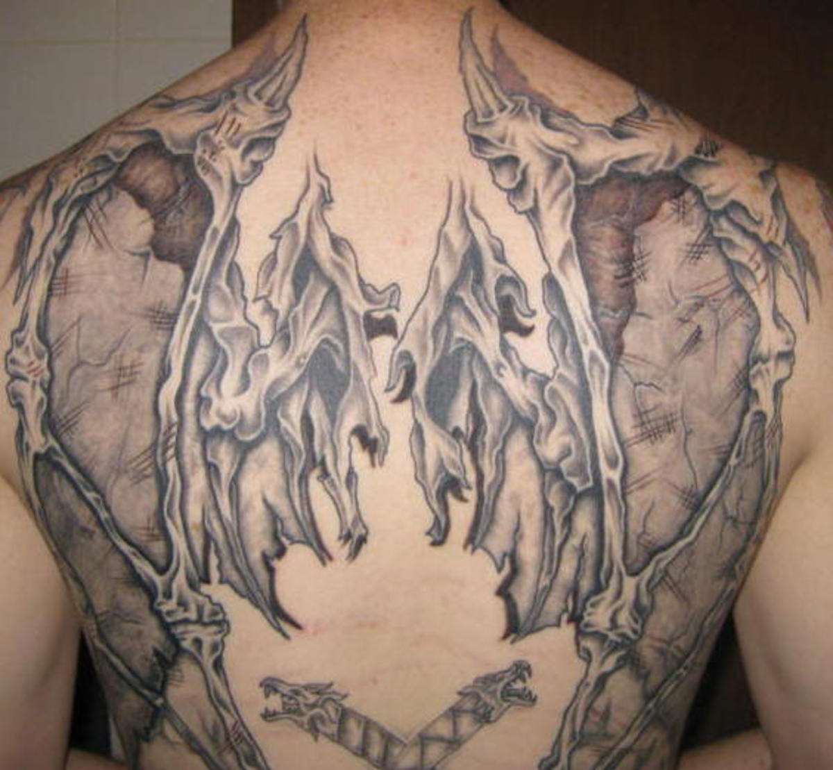Shredded, Skeletal Wing Tattoo