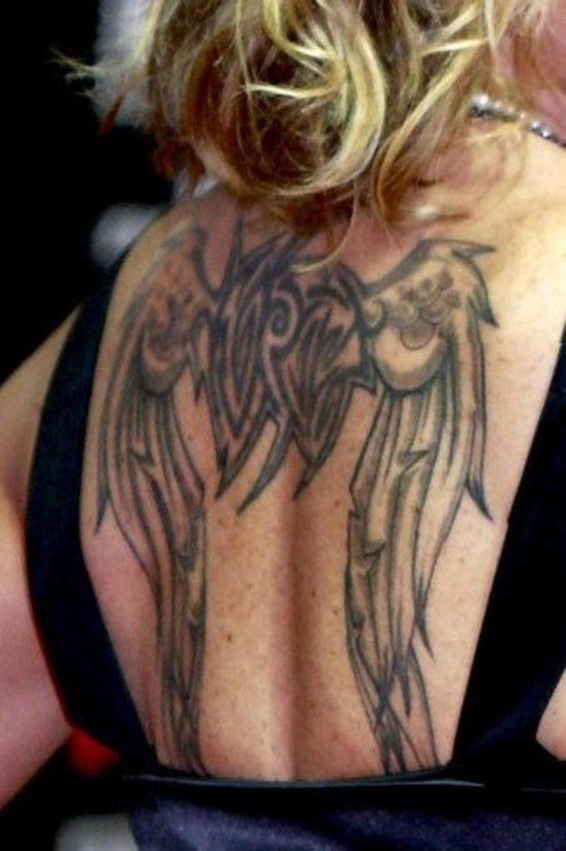 Anastacia's wing tattoo