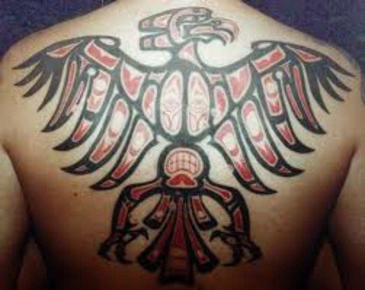 Tribal-style back tattoo.