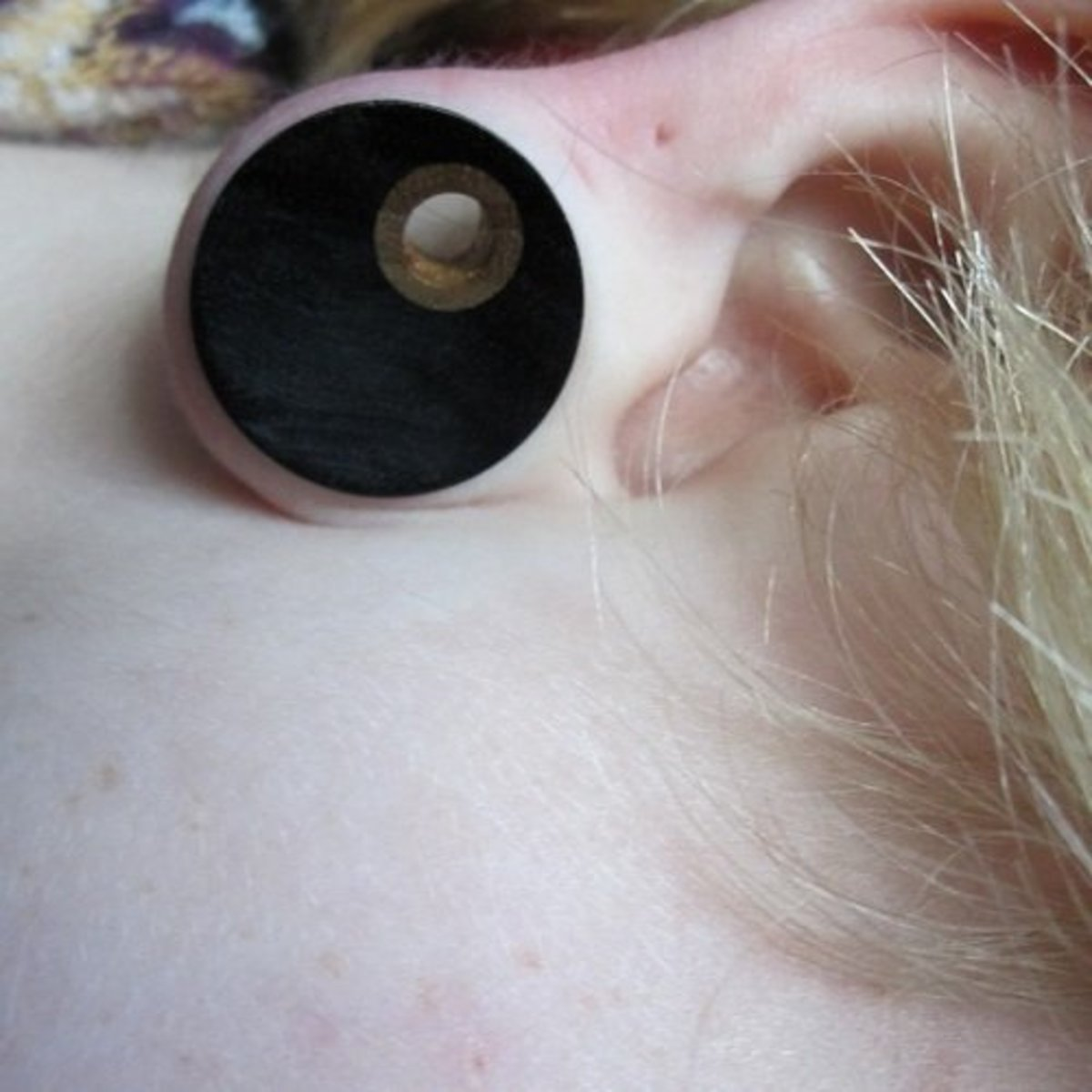 Some person wearing wood plugs. I don't know why the image is sideways.