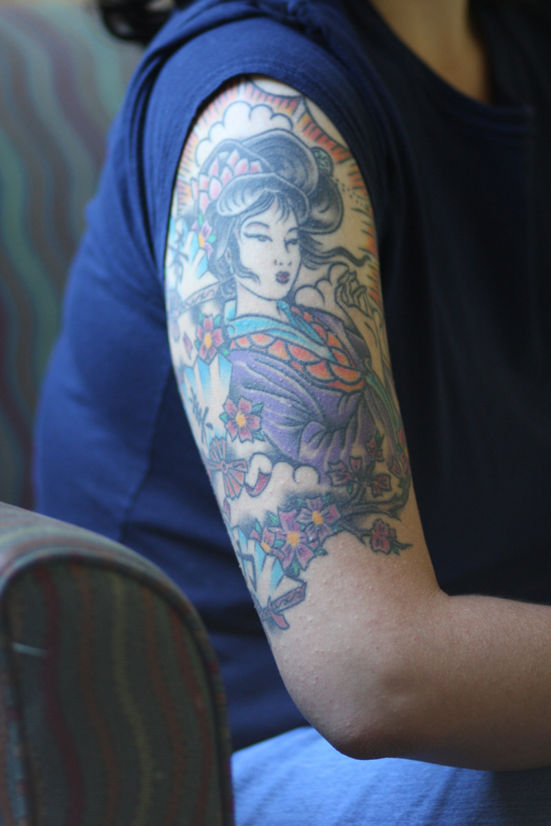 Biceps geisha tattoo.