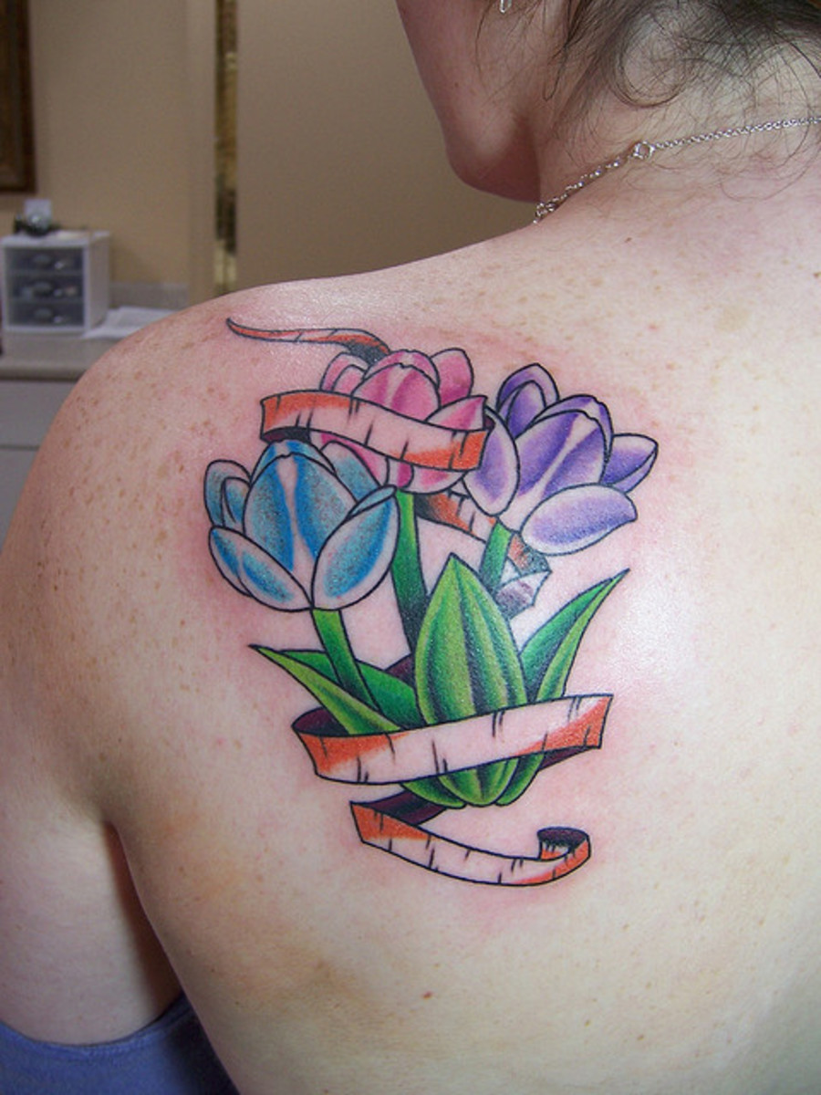group of colorful tulip tattoos on the back
