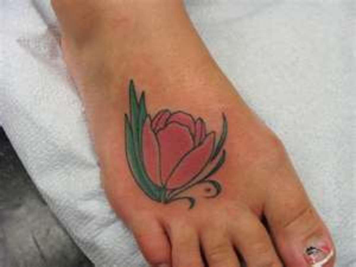 reddish-pink tulip tattoo on feet