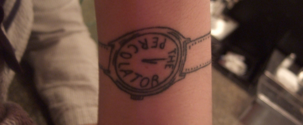 A wrist tattoo of a watch.
