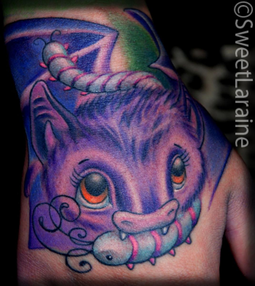 Cute bat tattoo.
