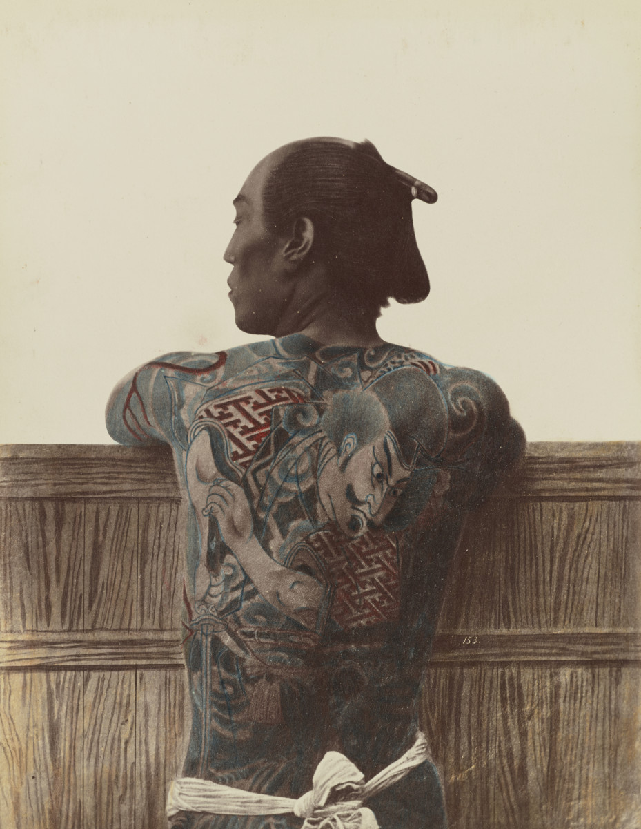 A photograph by Kusakabe Kimbei taken between 1870 and 1899 of a tattooed Japanese man. In Japan and China, tattoos were considered to be a spiritual enhancement.
