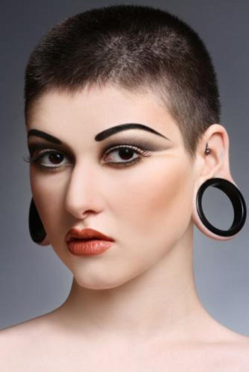 A woman with flesh tunnel gauges.