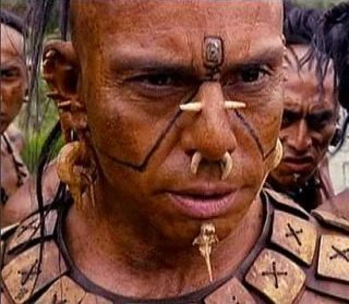 Tribal leader with facial gauges