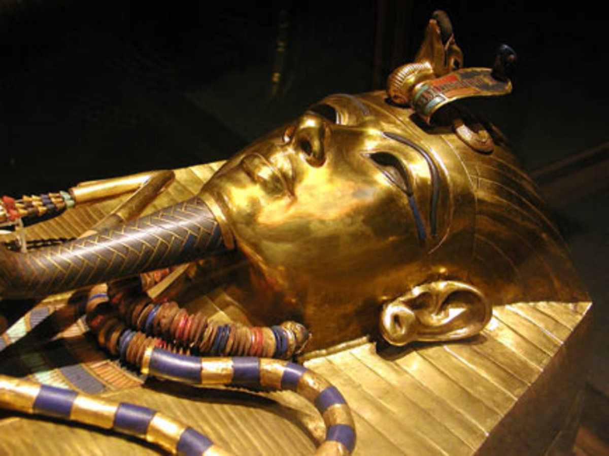 King Tut's coffin with gauged earlobes