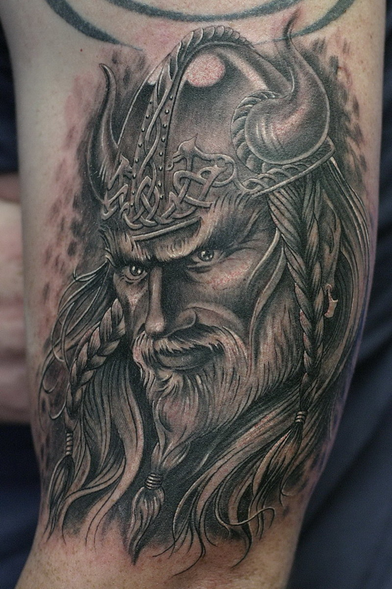 This Viking tattoo looks so alive due to its high detailing and brilliant use of black and white colors.