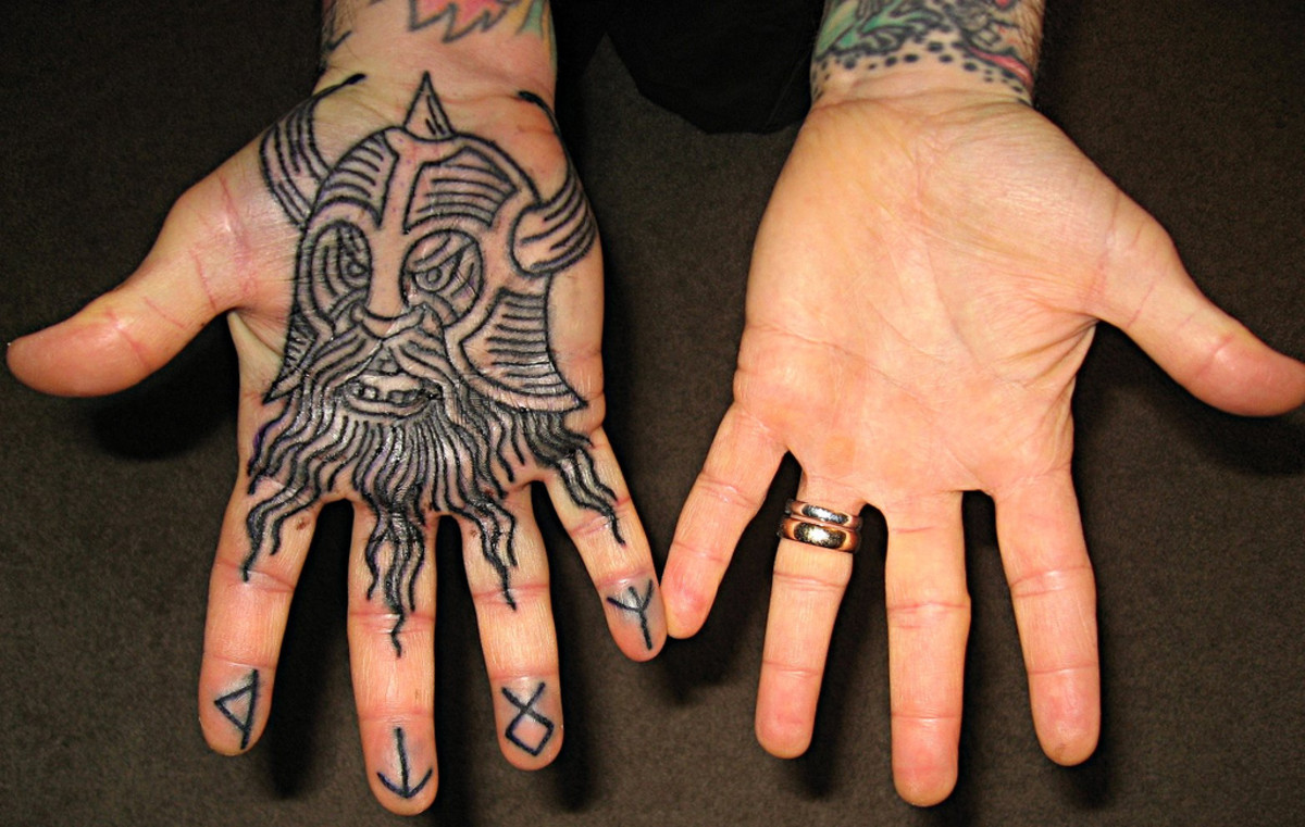 Quite uncommon location for a Viking tattoo yet a fierce one none the less. :)