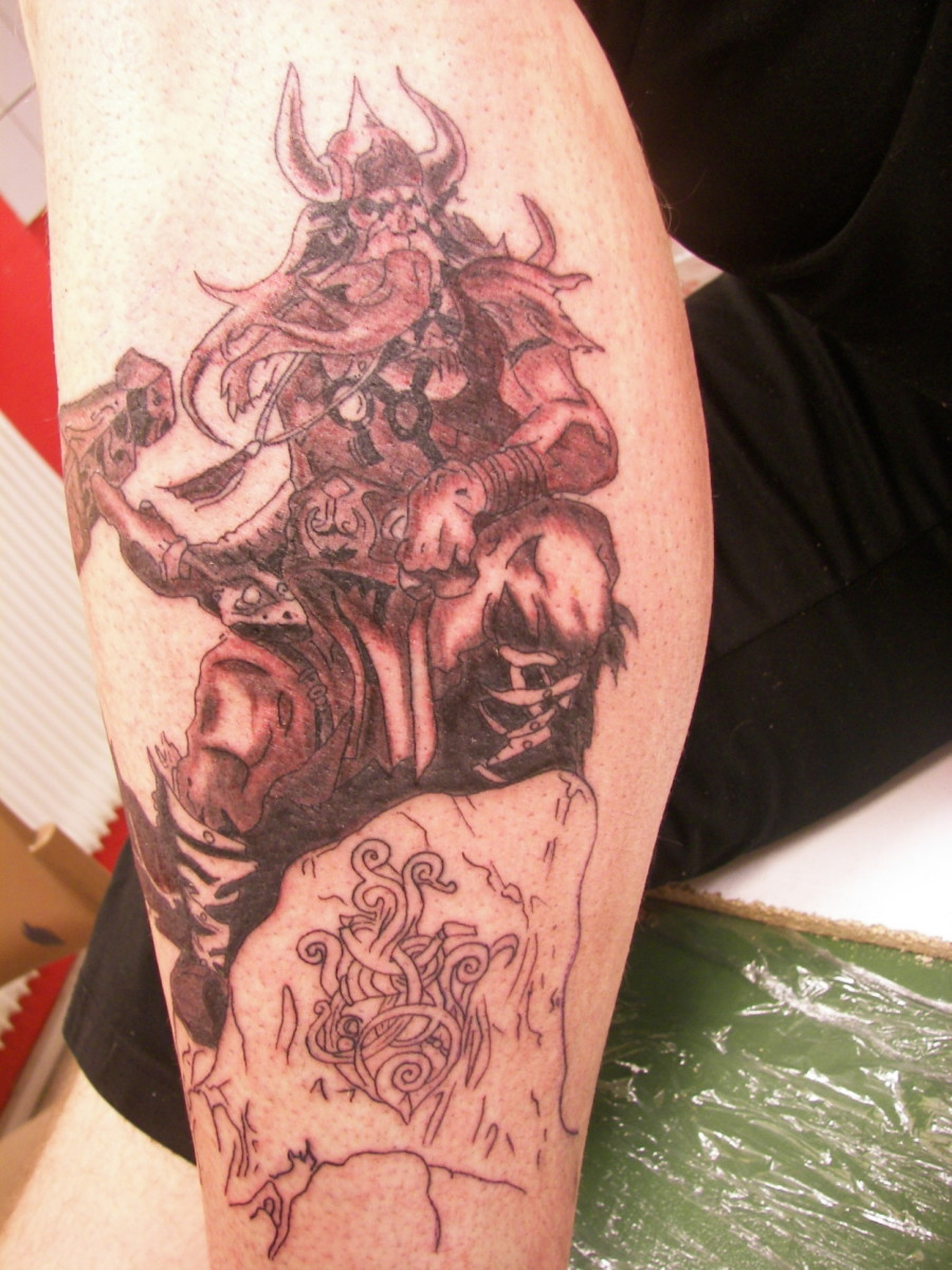 Thor the Viking God of thunder in Sepia on the leg.