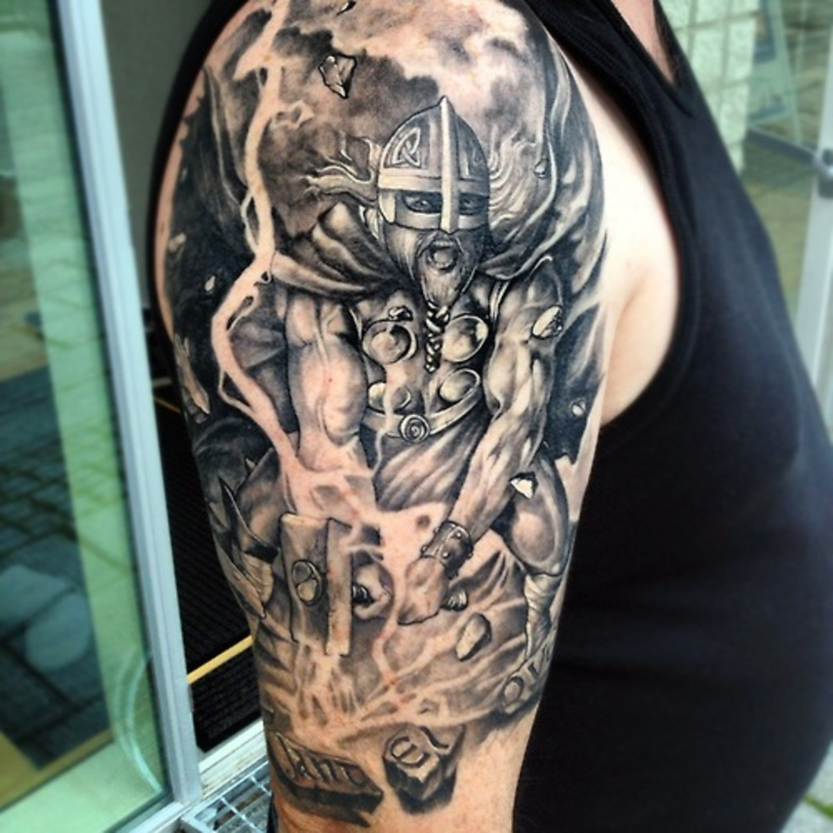 Stunning tattoo of Viking God of Lightning Thor & his mighty hammer at work.