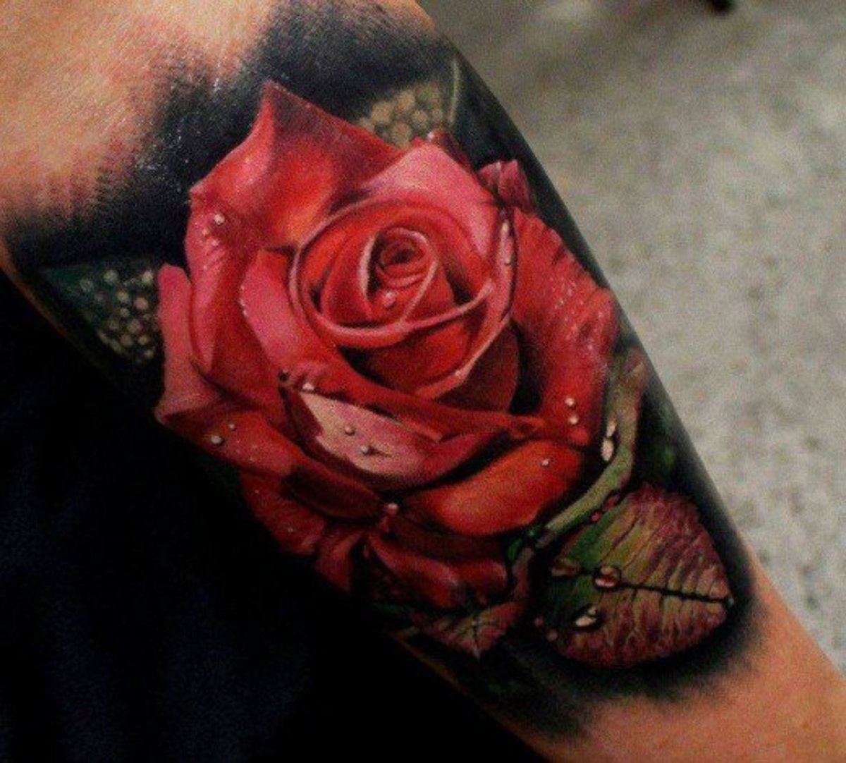 Rose tattoo on underarm
