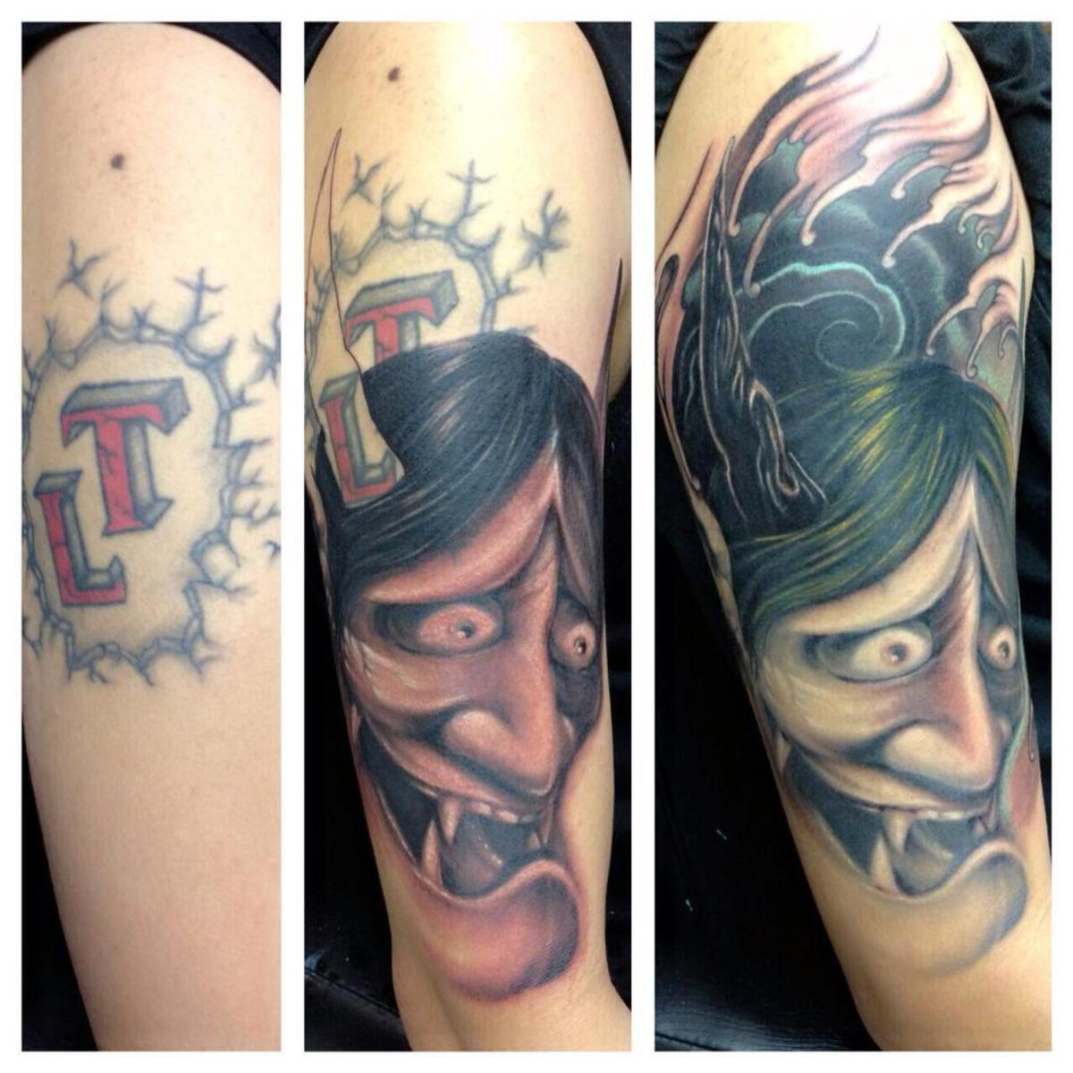 The use of the colour black has worked well with this tattoo, and the face draws the eye away from the cover-up itself.