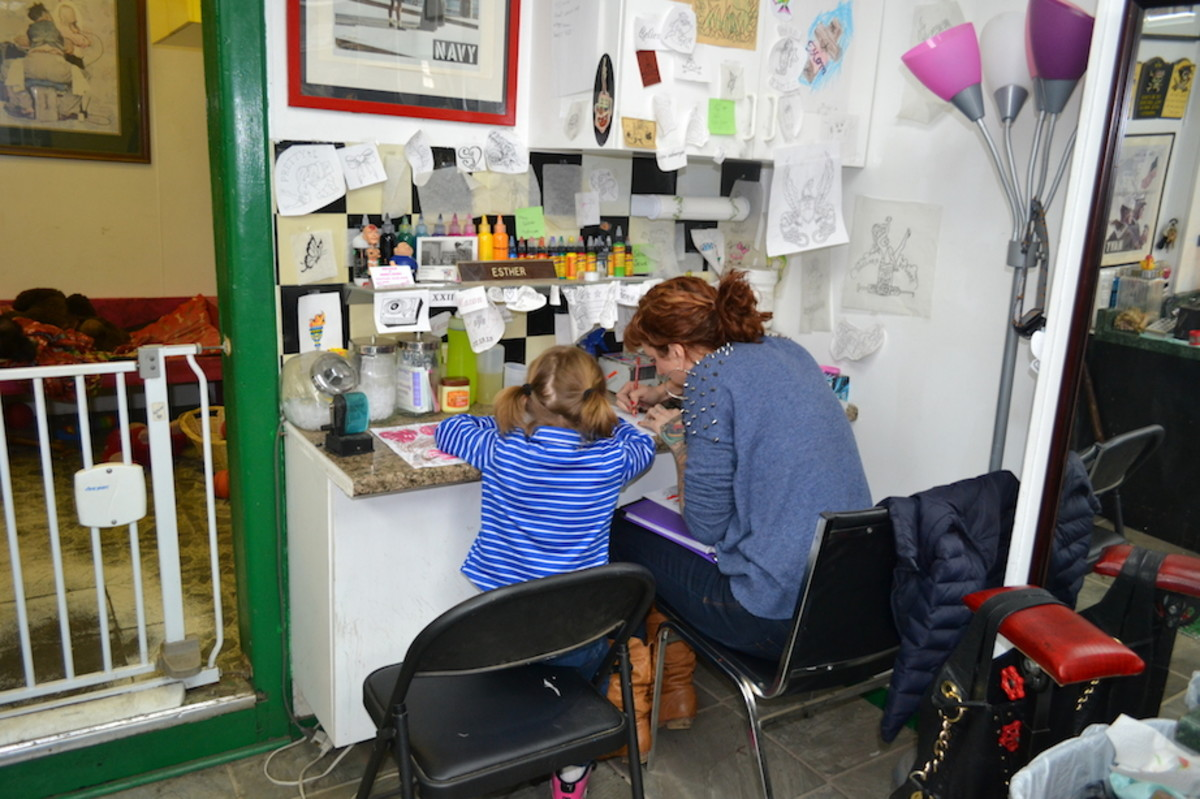 Suzie's daughter spends time at the shop with her and Eddie. They encourage her artistic pursuits.
