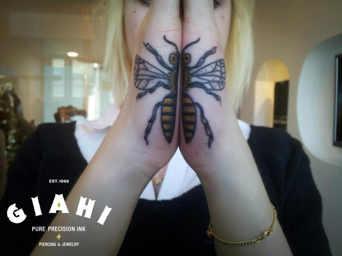 Palm tattoo of fly