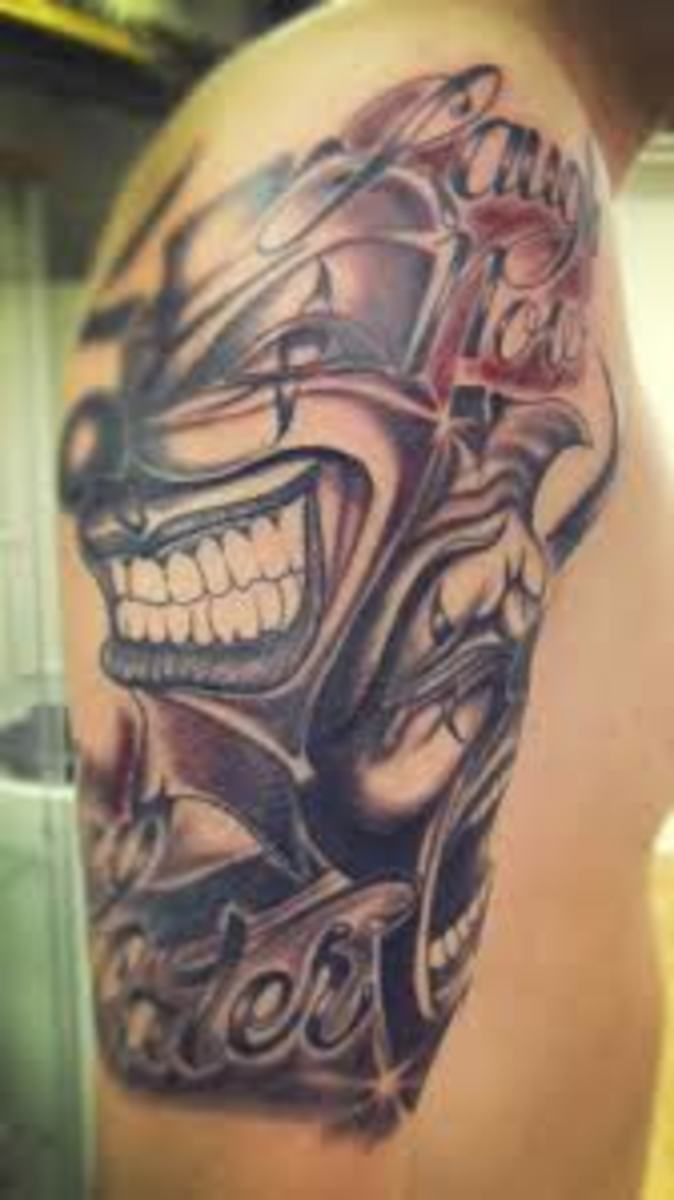 This tattoo emphasizes the black and gray, with just a touch of dark red.