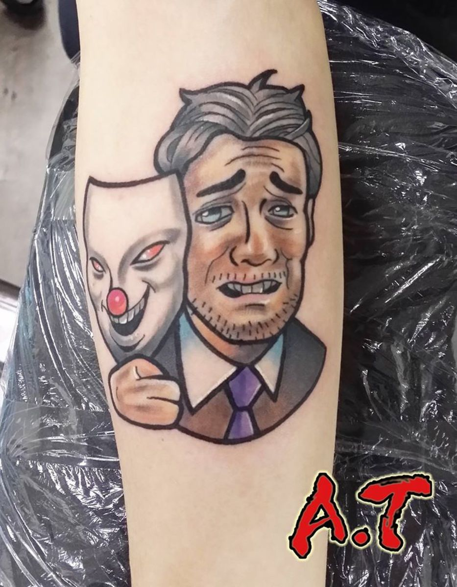 This version of the tattoo features a laughing mask and a real person crying.