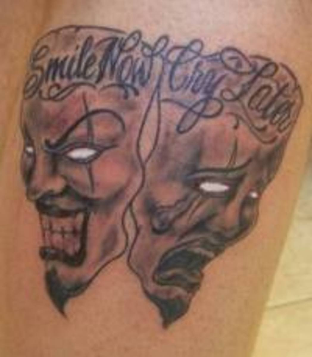"Another ""smile now, cry later"" tattoo in a similar style."