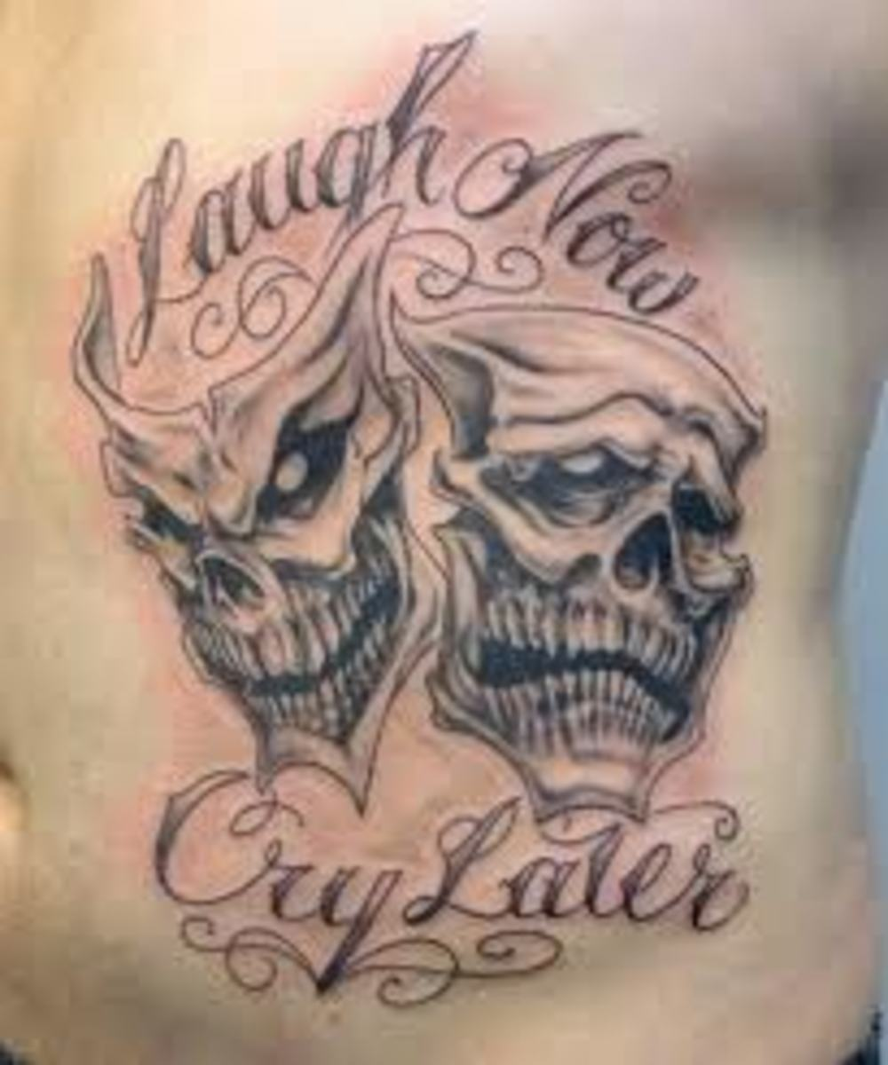The masks have a skeletal appearance in this tattoo.