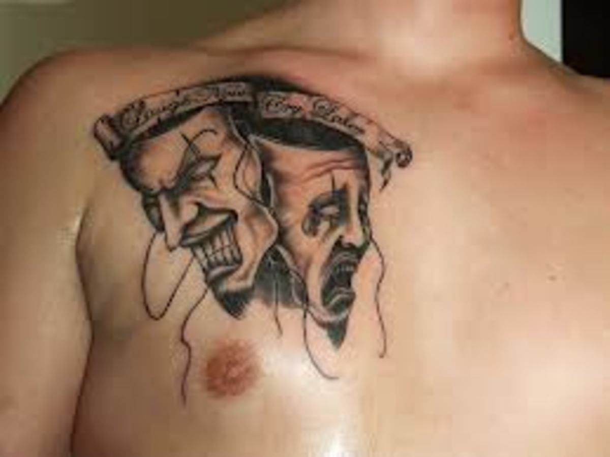 A chest tattoo where the masks are together.