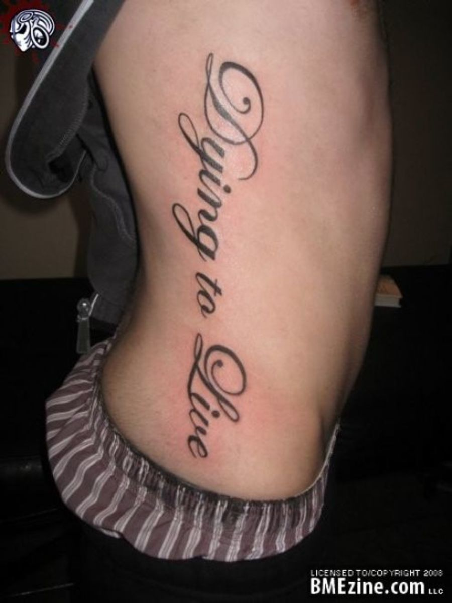 Dying to Live. Top 50 tattoo quote. Male, side tattoo.