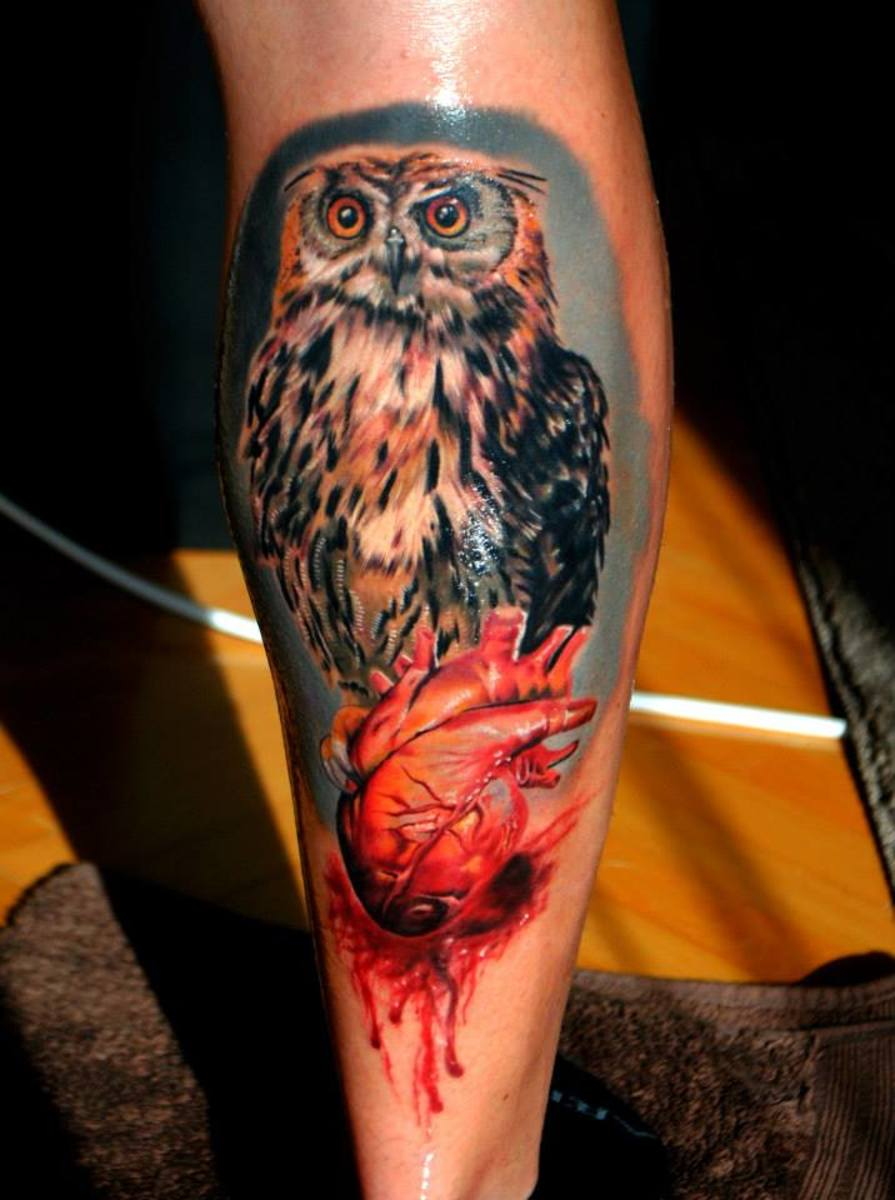 An amazing owl tattoo. It shines because tattoo aftercare cream has been rubbed in by the tattoo artist.