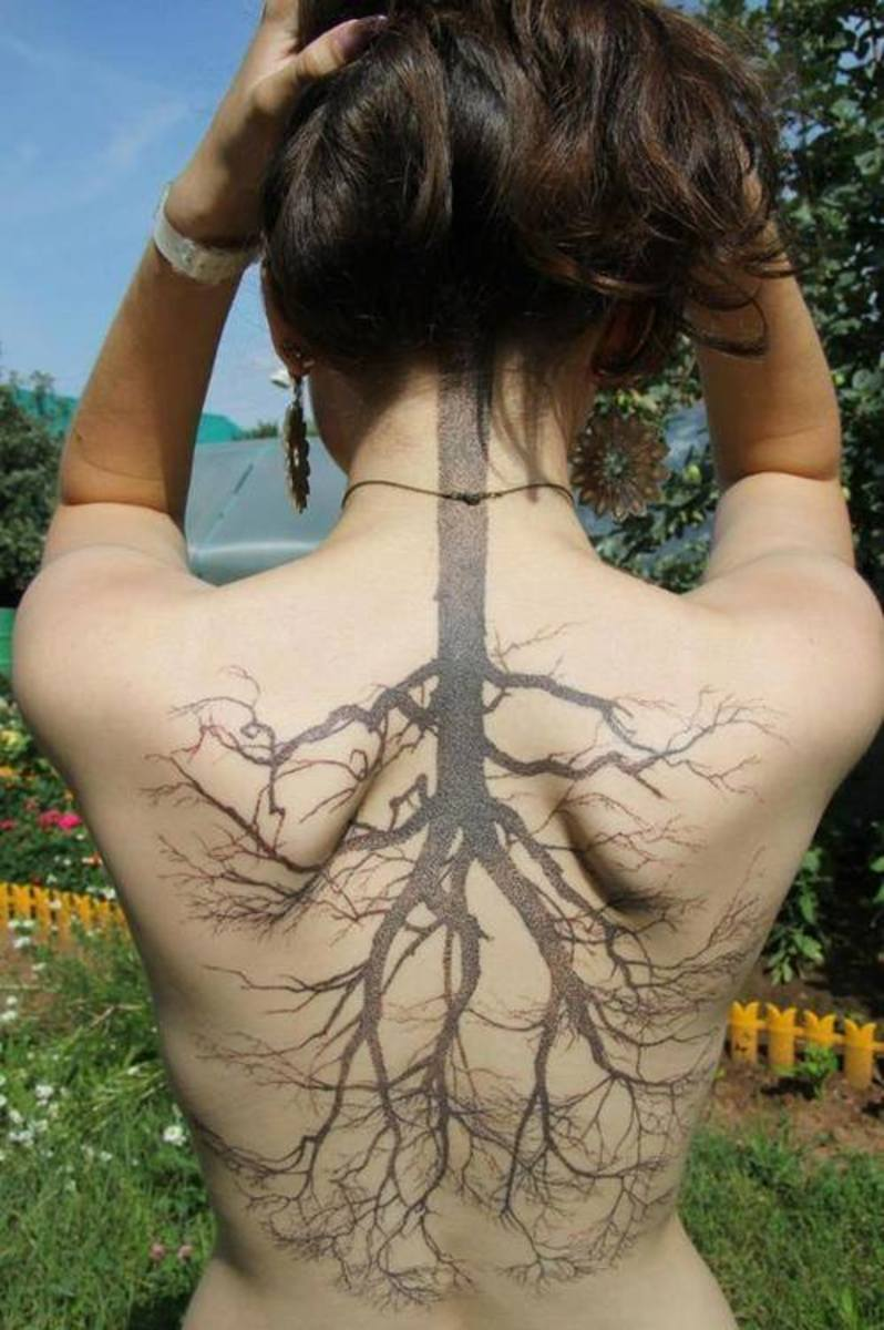 Back tattoo tree of life on girl