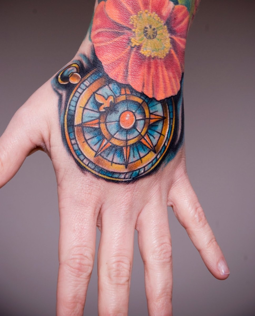 This hand tattoo is an extension of a full sleeve and it is awesome!