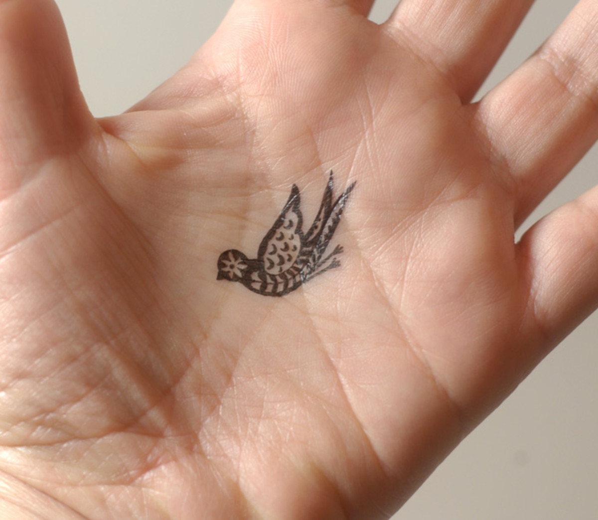 This hand tattoo looks lovely, but will the lines stand the test of time?