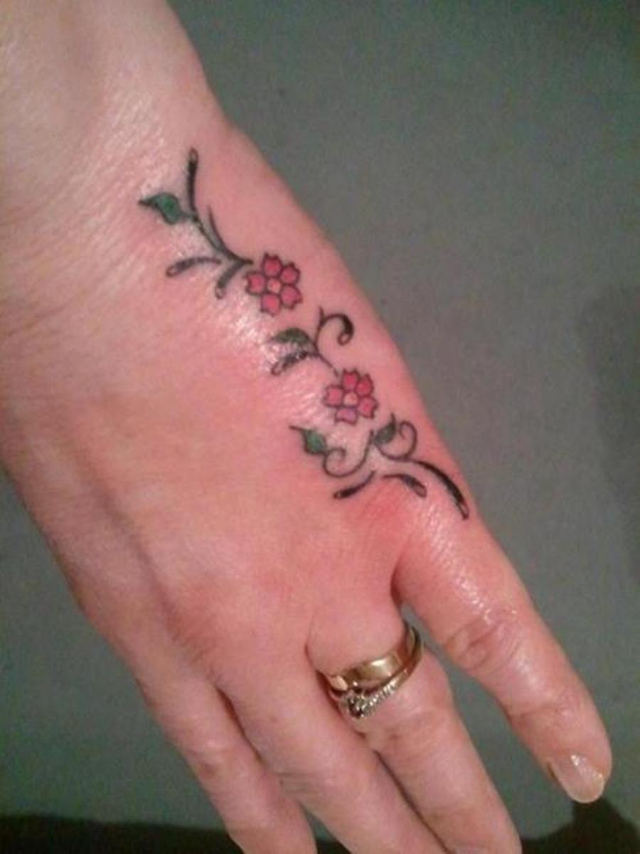 Pretty flower hand tattoos for Tattoos in private areas
