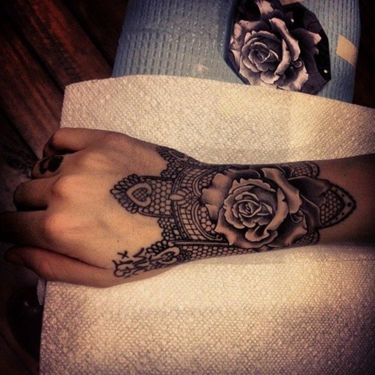Lace wrist tattoo. Old tattoos look new again.