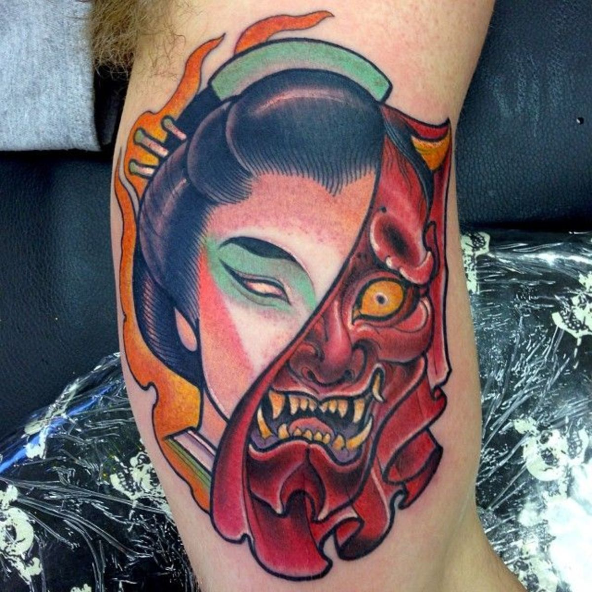 Another way tattoo artists are getting creative is by merging the skull or a woman's face to the Hannya mask.