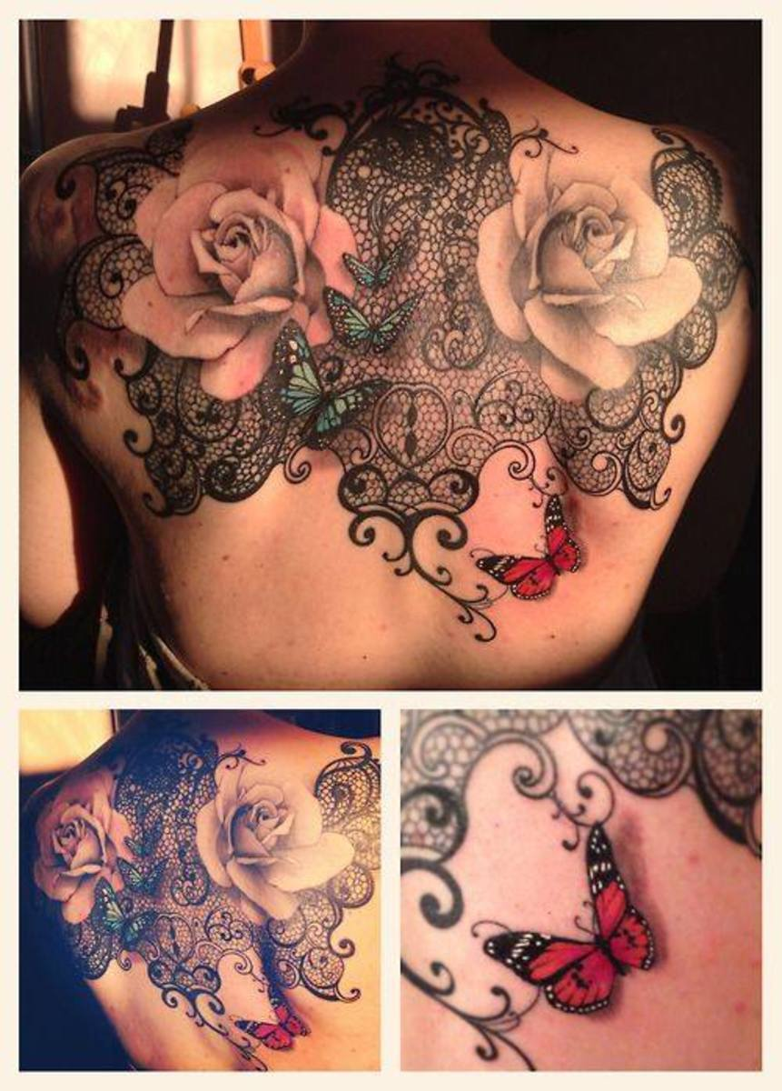 Back tattoo on girl with lace and roses