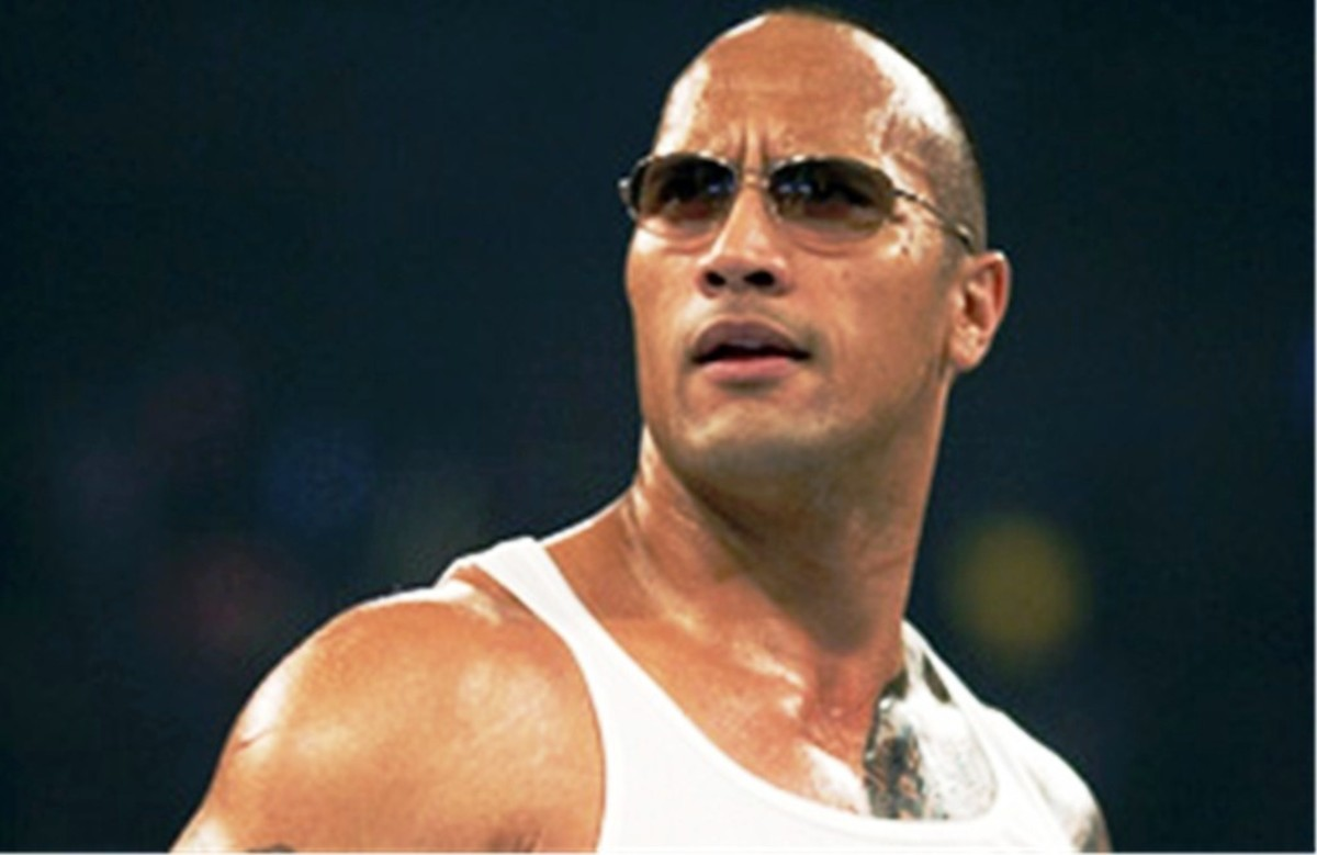 "The Evolution of Dwayne ""The Rock"" Johnson's Bull Tattoo"